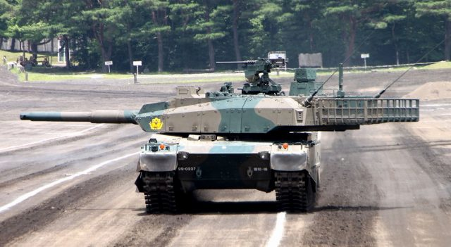 The Type 10 with its turret traversed to the right. Note the length of it with the rack included.