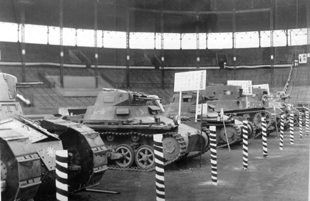 A Nationalist Renault FT, two Panzer Is (armed with Soviet machine guns), two T-26s (missing their armaments and mantlets), and just in shot, a Vickers Mark E Type B on display in Hanshin Koshien Stadium in Nishinomiya, Japan, February 1939