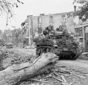 M3A3 Stuart passing by Coutances, Normandy, France, summer 1944.