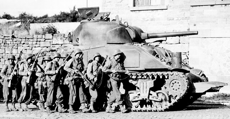 M4 in Belgium, advancing in close support of a US platoon, 1944